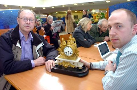 Ralph Johnson shows his mantle clock to valuer Niall Williams