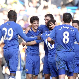 Oscar, second left, celebrates after scoring Chelsea's second goal of the game against Brentford