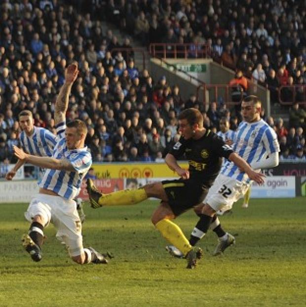 Callum McManaman, centre, scores the opening goal of the game for Wigan