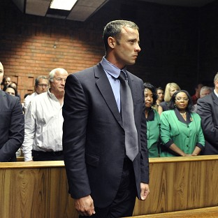 Oscar Pistorius stands following his bail hearing in Pretoria, South Africa (AP)