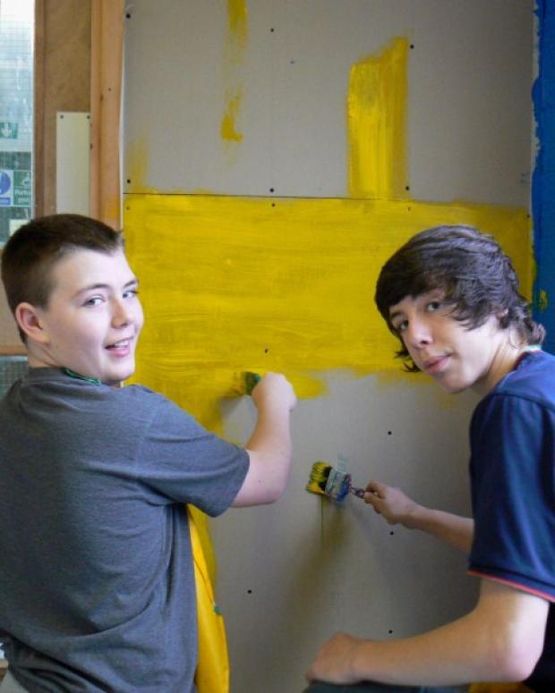 Students Kieran Ainscough and Will Duffy get busy with the paint brushes