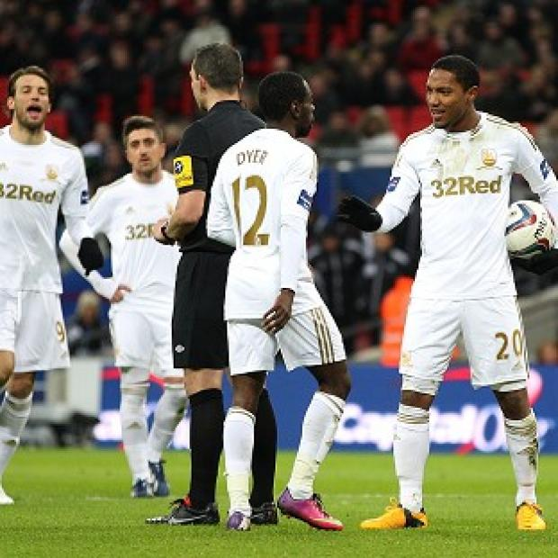 Jonathan de Guzman and Nathan Dyer argue over penalty taking duties at Wembley