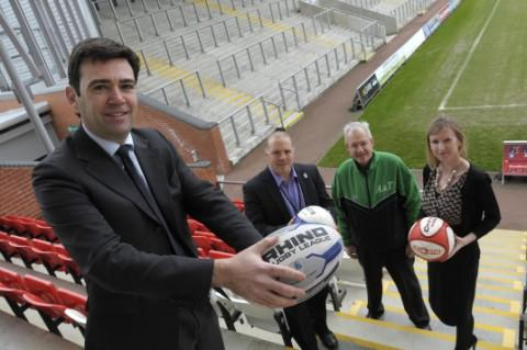 At the Leigh Olympics launch are, from left, Andy Burnham MP, Simon Town, chief executive of Leigh Sports Village, Mike Hack, from Astley and Tyldesley Cycle Speedway Club, and Hayley Smith, editor of the Journal