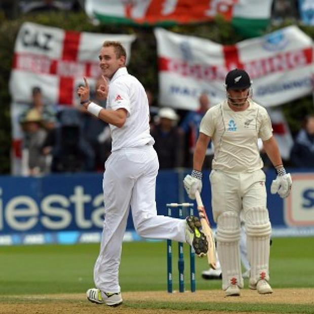 Stuart Broad, left, celebrates taking the wicket of Hamish Rutherford during day two of the second Test