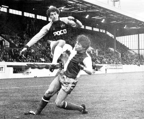 The Bolton News: Fazackerley challenges Burnley's Martin Dobson