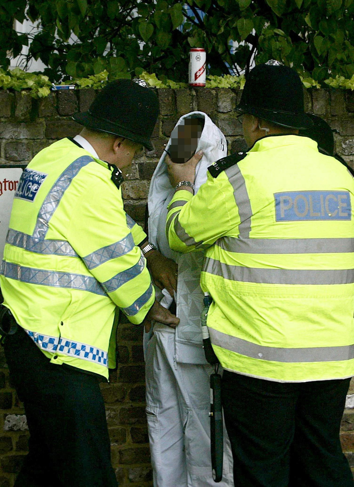Stock picture of police carrying out a stop and search