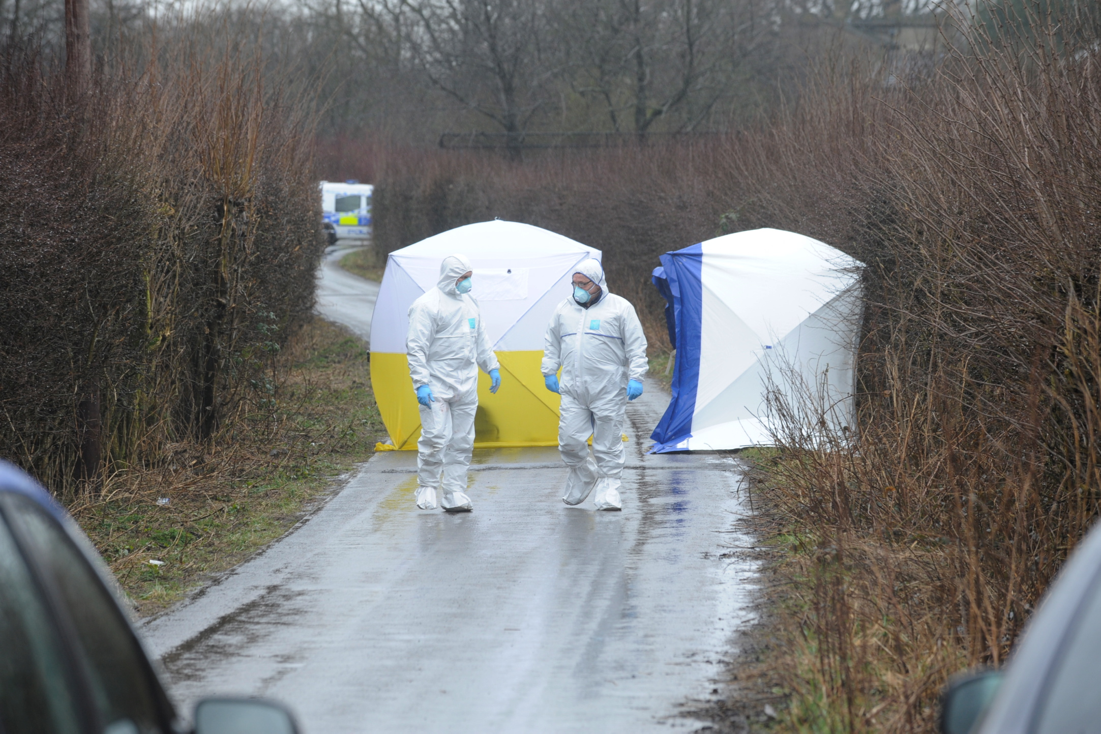 Forensic investigators in Ox Hey Lane, Lostock, where baby Alia was found.