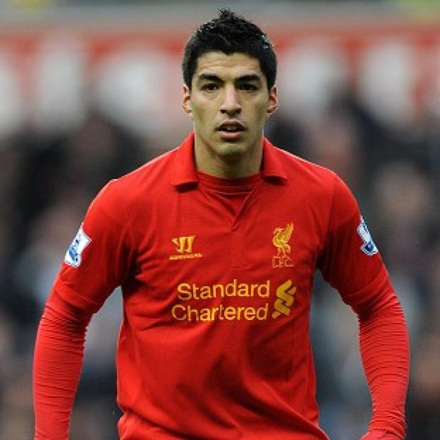 The Bolton News: Luis Suarez has been hit with two lengthy bans during his time at Anfield