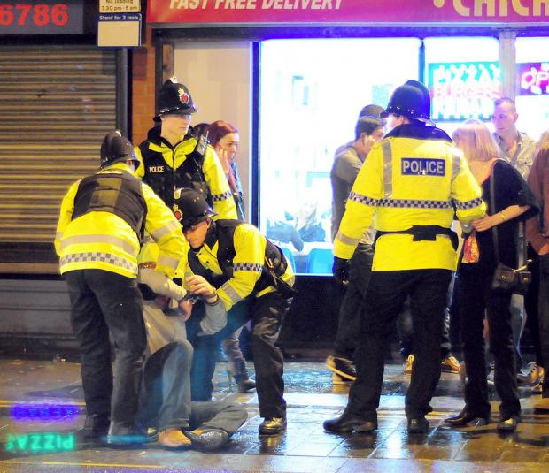BOOZE: Police dealing with the effects of alcohol in the town centre at night