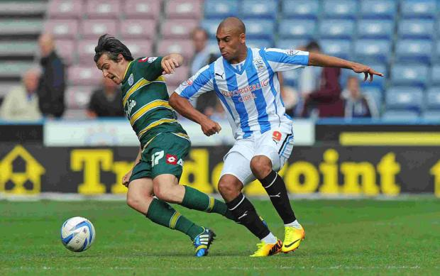 James Vaughan, right, tussles with QPR's Joey Barton