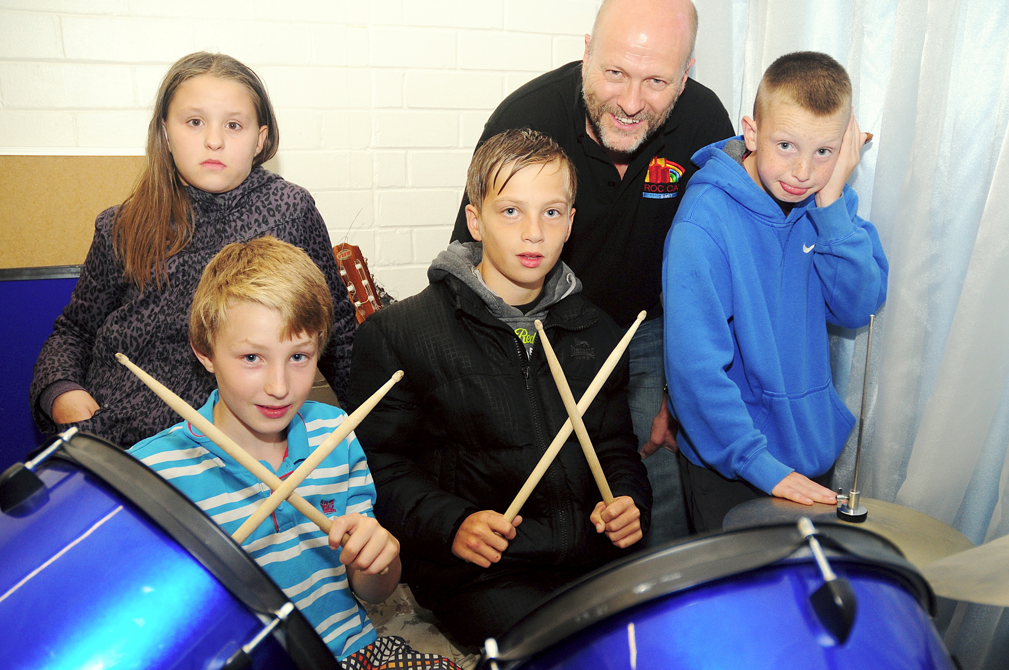 DRUM BEAT Volunteer Simon Wilson teaches drums to, from left, Angel McCann and Dylan Gregory, both aged 11 and Edmund Walsh and Findlay Bailey, both aged 12