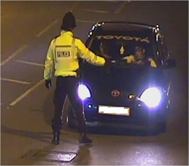 DO YOU RECOGNISE THIS CAR? The car shortly before it was used to drive into a police officer