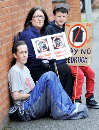 Jacqueline Galloway in a sleeping bag with campaigner Linda Charnock and her grandson Kyle Leech, aged nine, at a 'bedroom tax' sleepout protest