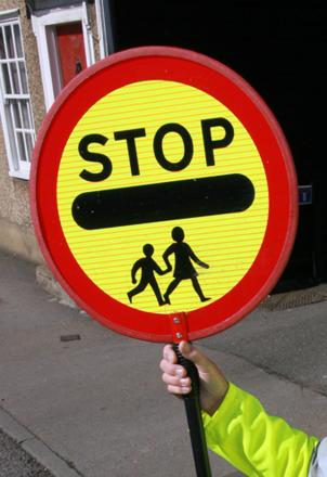 Lollipop ladies will still have to turn up for work - even though schools are closed