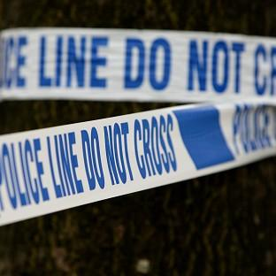 The body of a woman was found at an address in Barnet, north London, after officers forced their way into the property
