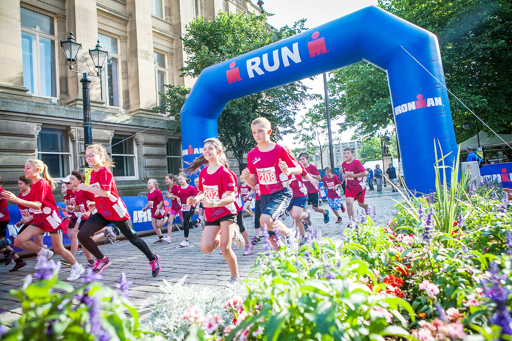 AND THEY'RE OFF Youngsters run round Bolton Town Hall in this year's event