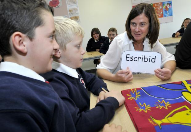 WORD TASK Head of languages, Karen Greenwood puts the youngsters through their paces with a language game