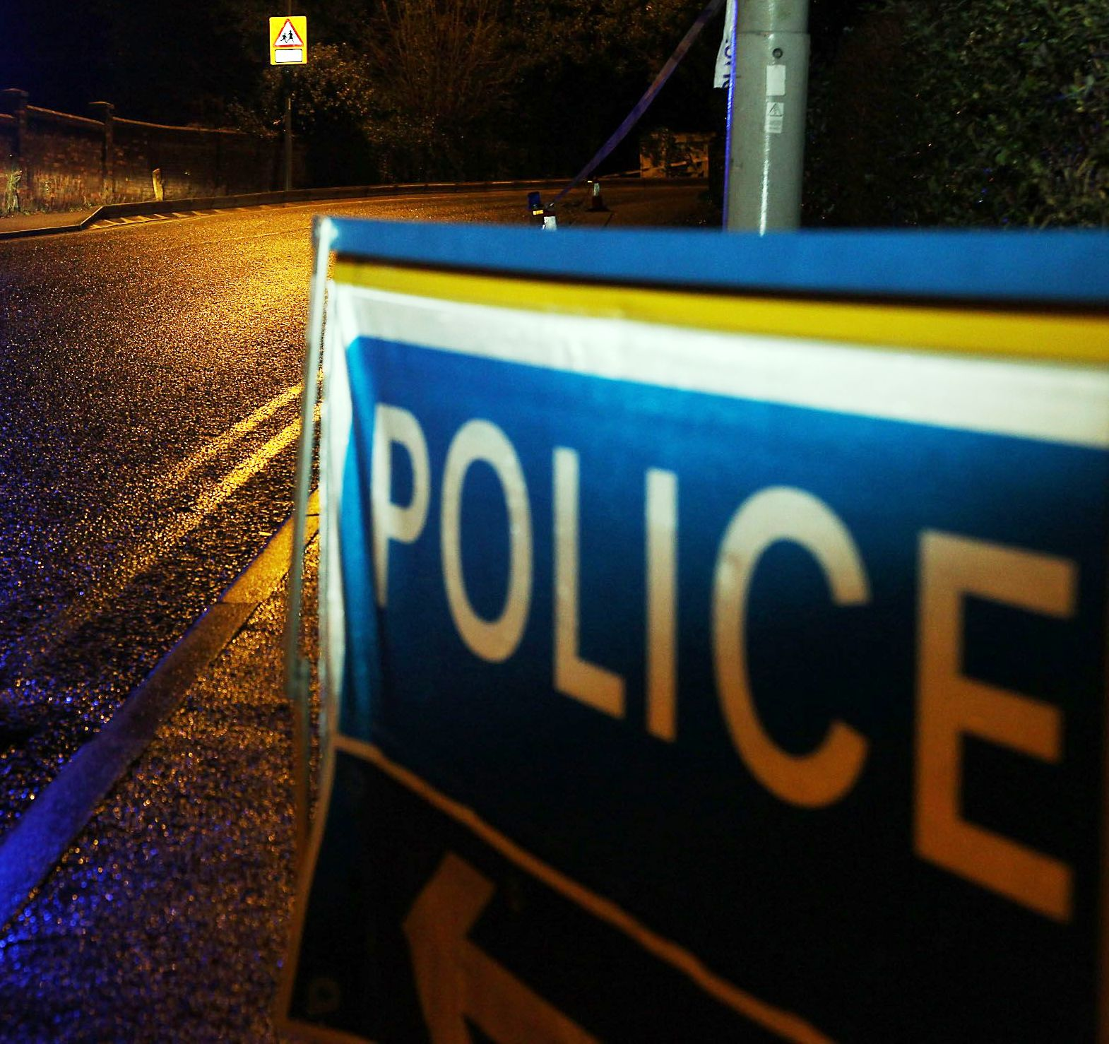Road closed after man threatens to jump from bridge
