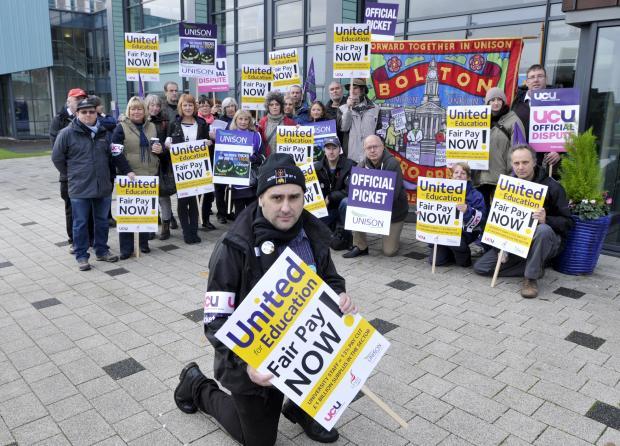 University staff on strike, with union secretary Damien Markey at the front