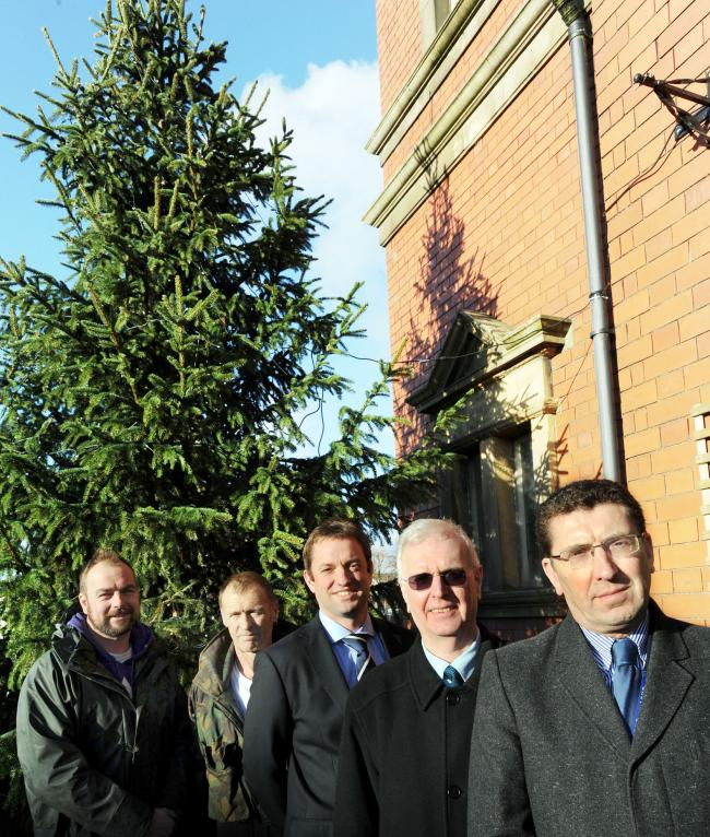 From left Jamie Arden, boss of Bolton Christmas trees, Lee Paterson who put the tree up, Neil Turner organiser, Stephen Tonge chairman of Churches on the Mount, Tony Lasan, headteacher St Stephen's, Kearsley