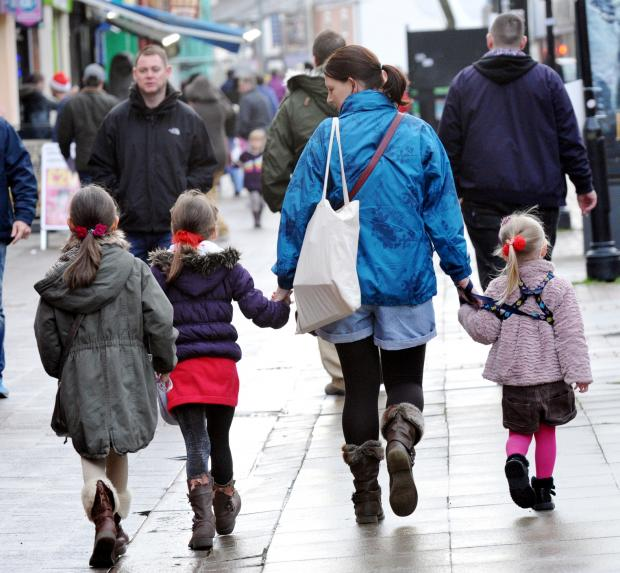 Shoppers in Bolton town centre
