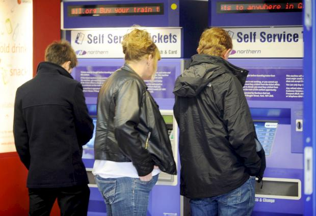 The Bolton News: Passengers try to buy tickets at Bolton's Trinity Street rail station