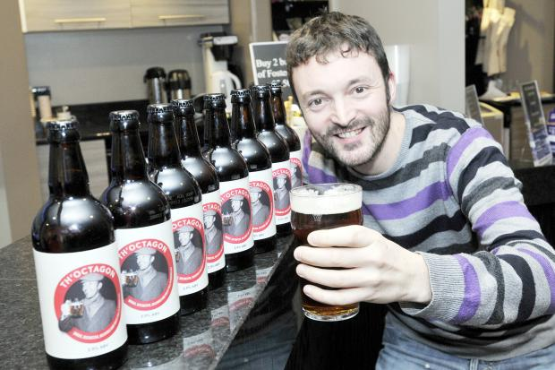 Theatre chief electrician Andy Smith says cheers with a pint of Th'Octagon