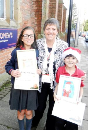 Julie Hilling MP with Christmas Card Competition winner Emma Joseph and runner-up Adam Mortimer