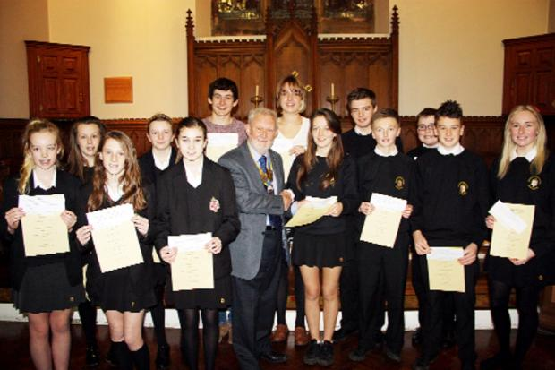 Horwich Rotary Club president Ted Wisedale presents awards to youngsters at Rivington and Blackrod High School