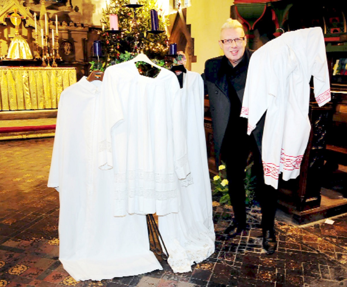 Father John Wiseman with the returned garments