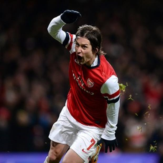 The Bolton News: Tomas Rosicky celebrates scoring the second goal