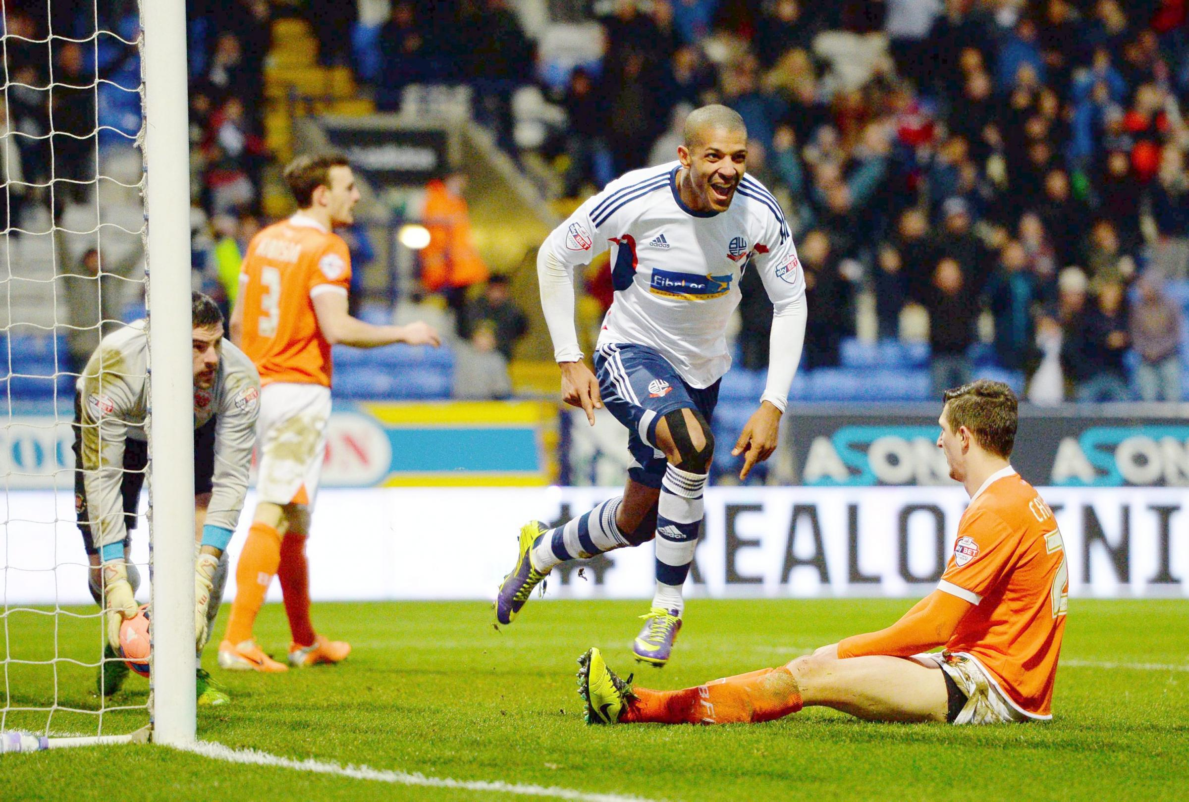 Jermaine Beckford celebrates the goal which takes Wanderers into the fourth round of the FA Cup