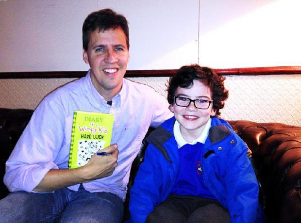 Monty Lord meets his hero Jeff Kinney and, below, shows off one of the American's Diary of a Wimpy Kid books