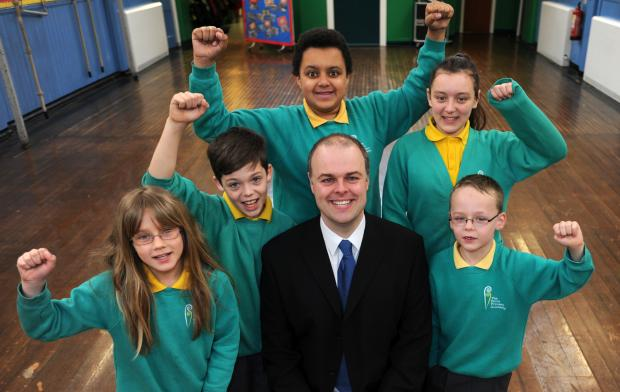 Stephen Drury, vice principal of The Ferns academy in Farnworth, with pupils, from left, Katelyn Dodgin, aged nine, Thomas Greenhalgh aged 11, Morgan Sterling-Schofield aged 11, Tia Gornall, aged 10, and Cameron Gibbons, aged six, celebrating a good Ofste