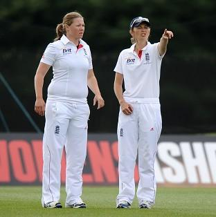 Anya Shrubsole, left, picked up two wickets for England late in the day