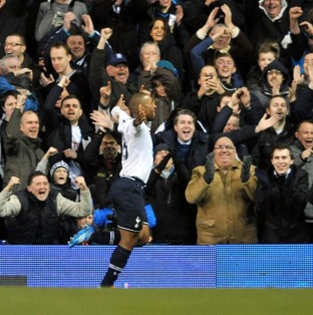 The Bolton News: Jermain Defoe celebrates with the Tottenham fans after making it 2-0