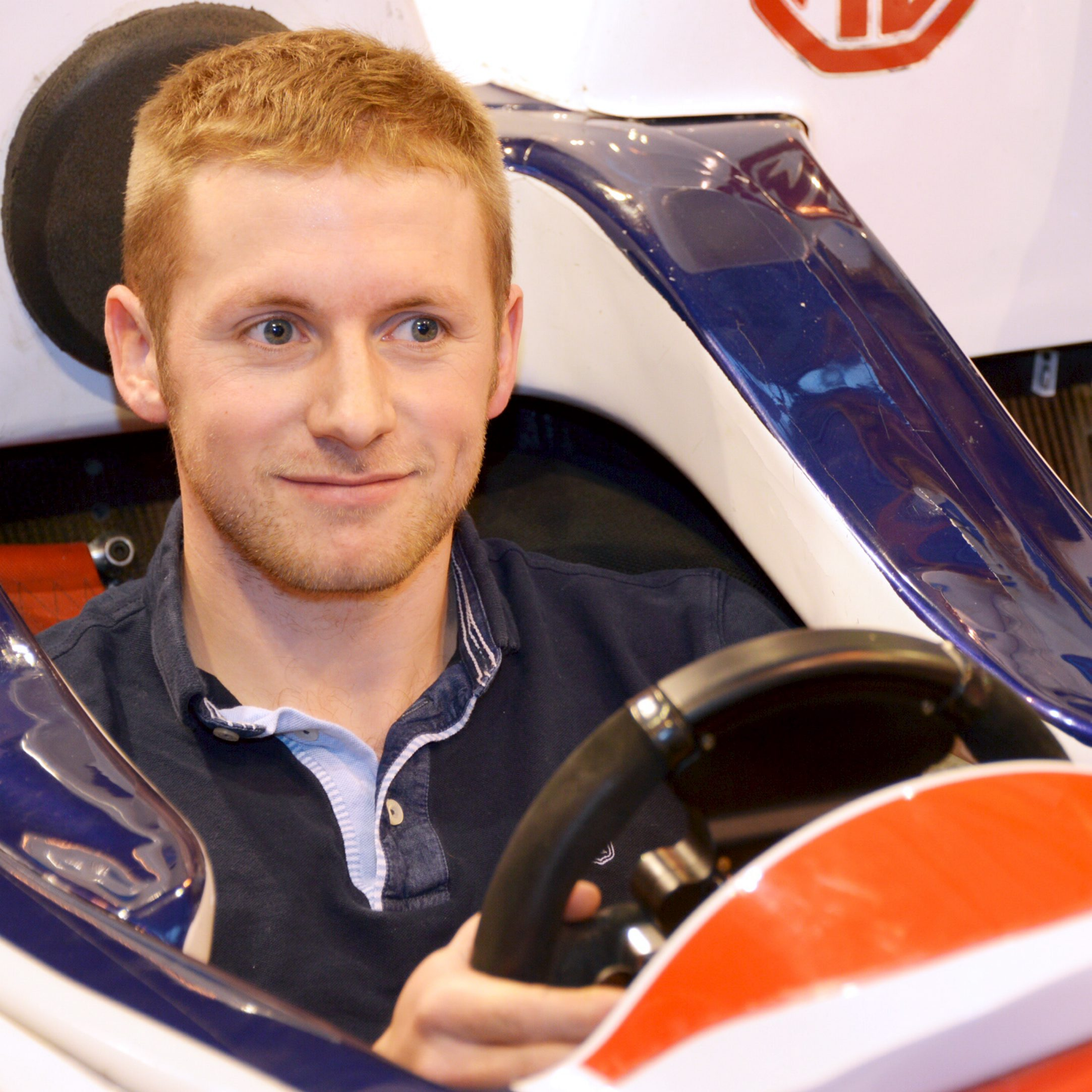 Olympic cyclist Jason Kenny competes against public on racing simulator