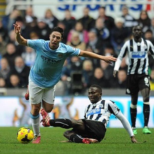 The Bolton News: Samir Nasri, left, is set to miss eight weeks