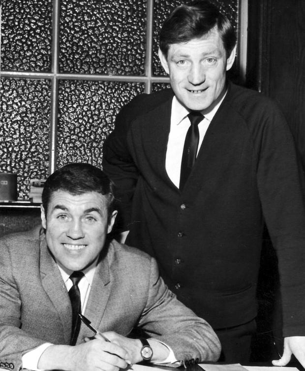 The Bolton News: Bobby Collins, left, signs for Bury in 1967 with manager Les Shannon