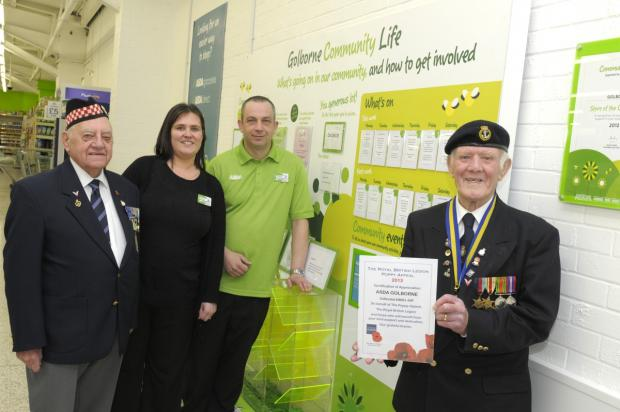 The British Legion's Tommy Atherton and Harry Gray thanking Asda service manager Sharon Hadgraft and Richard Barber