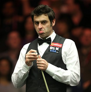 Ronnie O'Sullivan, pictured, moved into the second round by comfortably beating Robert Milkins
