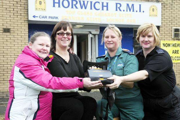 At Horwich RMI with a new defibrillator are, from left, first responder Tammy Harrison, first-aider at Horwich RMI Clare Boyle, community resuscitator training officer Lisa Stanway and PC Jane Wilcock
