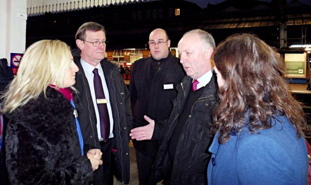MP David Crausby, second right, talks to transport representatives at Bolton railway station