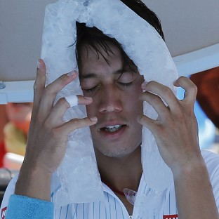 Kei Nishikori of Japan cools down with an ice pack at the Australian Open tennis championship in Melbourne (AP)