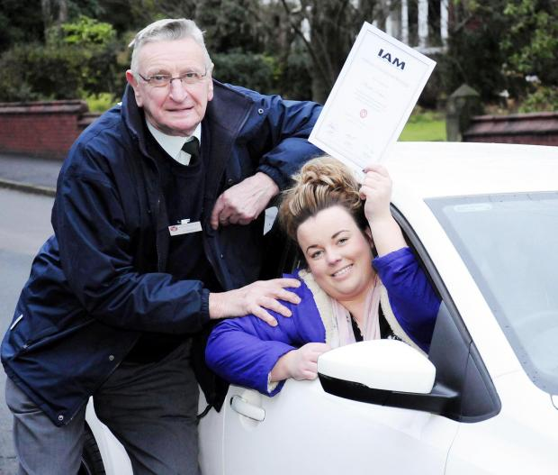 The Bolton News: Phoebe Dobson waves her Advanced Motorist pass certificate congratulated by her grandad, Ted Rowson
