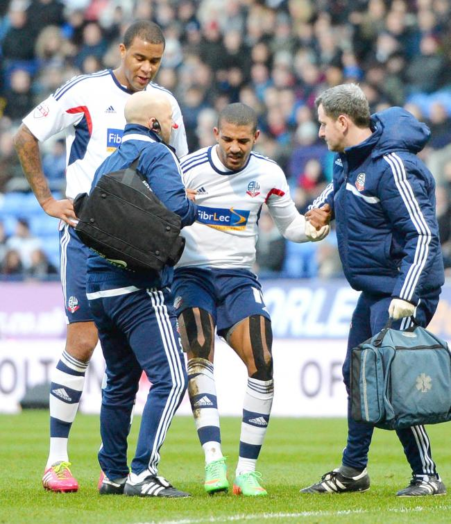 PAINFUL Jermaine Beckford is helped up after his injury