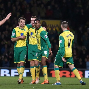 Ryan Bennett, centre, is mobbed by his team-mates after netting the winner