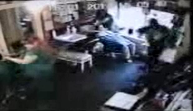 A knife-wielding robber threatens staff at Talking Heads hair salon in Deane