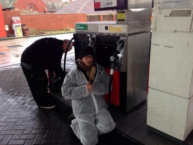 The Bolton News: Four arrested after anti-fracking campaigners glue themselves to petrol pumps