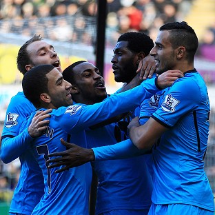 Emmanuel Adebayor, second right, bagged a brace for Tottenham
